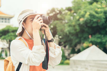 Tourist travel and take a photo outdoor with space for text