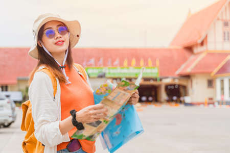 Girl teen tourist holiday trips with map travel at Chiang Mai Thailand.