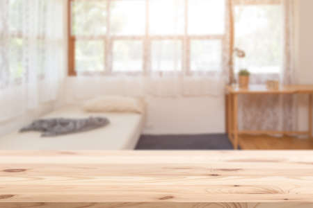 wooden table top with blur home comfort classic bedroom for products montage advertising background