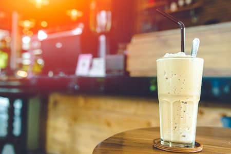 Coffee Smoothie milk shake sweet cool ice blended drink with caffeine refresh menu on coffee shop table with space for text Zdjęcie Seryjne