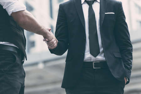 Businessmen making handshake for dealing business project agree concept