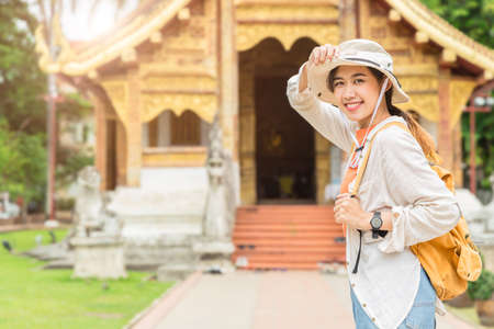 Asian girl teen enjoy smiling travel at Thai temple in Chiang Mai Northern province of Thailand