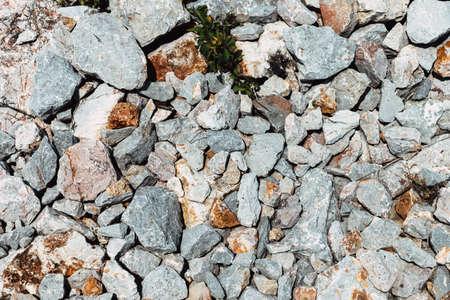 Coarse grinding granite rock stone on the ground 免版税图像