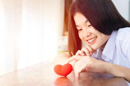 Asian girl teen lovely university cute smiling with red heart for love together Valentine day concept