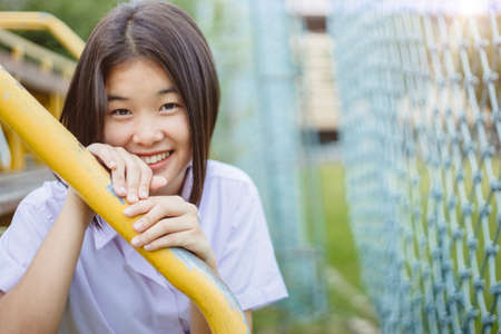 Asian student girl teen innocent shy smiling and looking camera with copy space