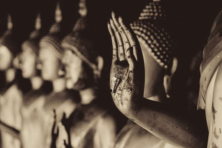 Closeup beautiful Buddha hand statue  beautiful culture of Asian calm and peaceful in Thailand mono color tone photography