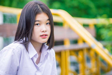 Asian university student girl teen innocent naive look with copyspace