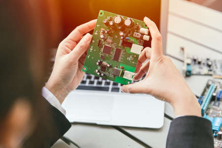 Engineer inspect final production of Printed circuit computer logic board of router modem prepare for mass production process. Zdjęcie Seryjne
