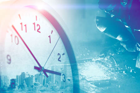 Industry worker overlay with Times clock for business working hours in factory image concept.