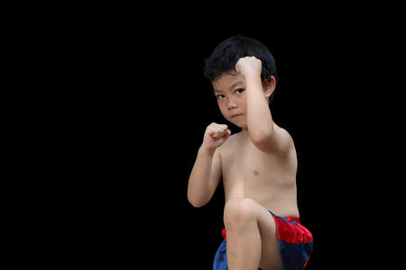 Boy or kid boxing fighter guard standing isolated on back background. Imagens
