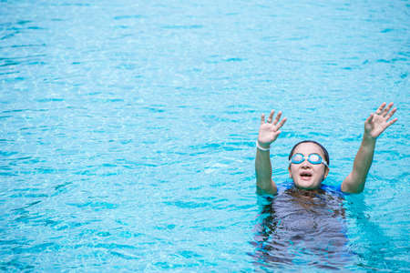 Drowning woman cramp while swimming, she raising her hand for help composition space for text.