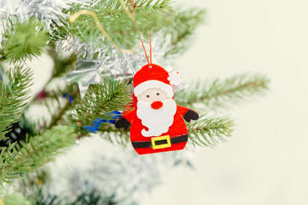 small cute santa decoration doll at pine tree for Merry Christmas and Happy New Year event celebration. Stock fotó