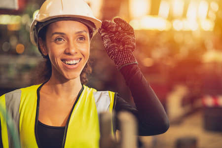African American woman happy worker engineering working smile labor in heavy industry factory with good welfare concept. Archivio Fotografico