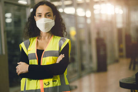 Portrait Women worker wear disposable face mask for protection Corona Virus Spreading and smoke dust air pollution filter in factory for healthy labor care.