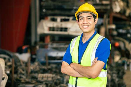 confident Asian male engineer worker standing arm crossed happy smile for enjoy working in factory Zdjęcie Seryjne