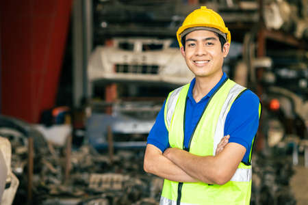 confident Asian male engineer worker standing arm crossed happy smile for enjoy working in factory Banco de Imagens