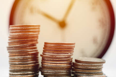 Money with the clock. Business Times wealth income concept. Stock Photo