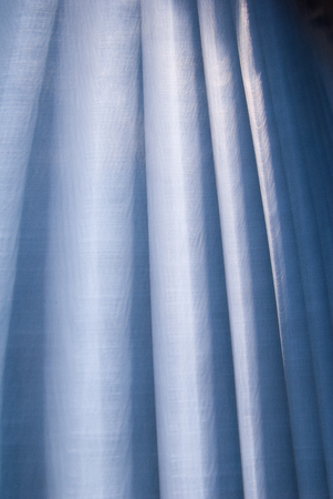 blue curtain: The sun is shining out of a blue curtain