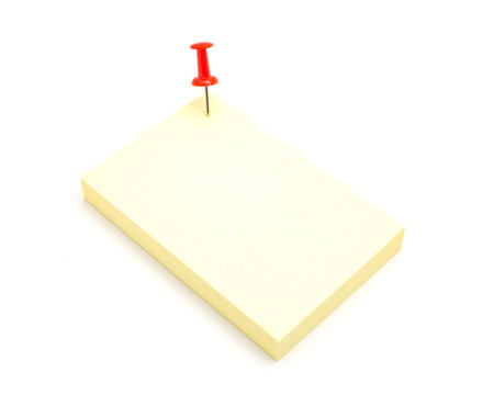 Red color push pin and yellow sticky note on isolated white background