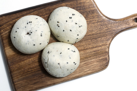 Glutinous rice cake on wood cutting board ; white background