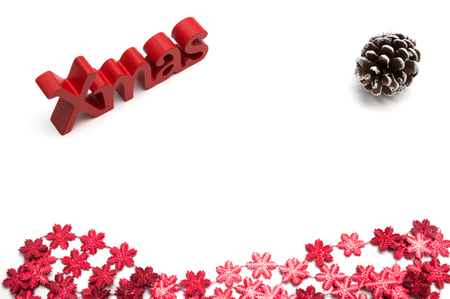 X-mas text and  pine coneon, red snow flower decoration white background