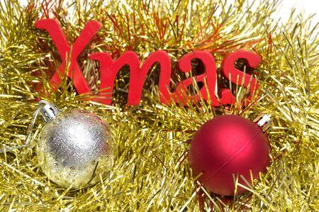 X-mas text and ball on christmas decoration