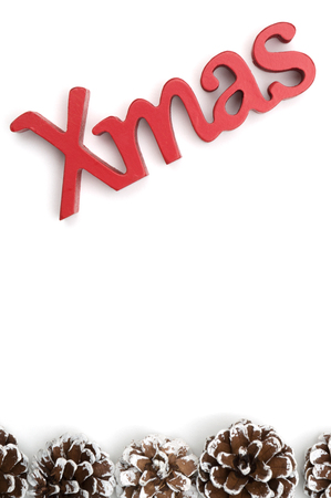 X-mas text and pine cone on white background