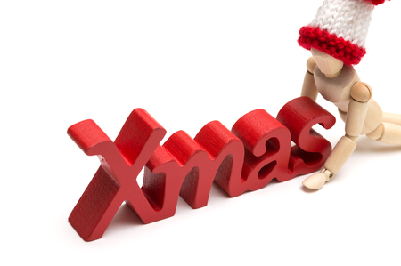 X-mas text and joint doll wearing a fur hat on white background