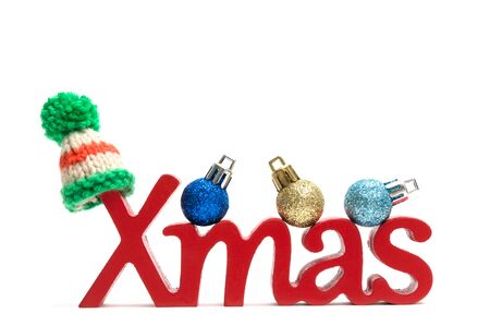 X-mas text and fur hat, ball on white background