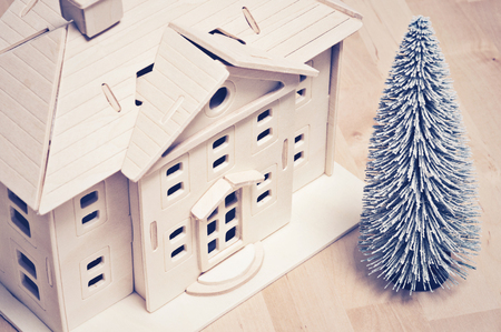 Miniature house and christmas tree Stock Photo