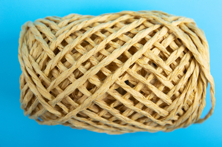 brown string on blue background
