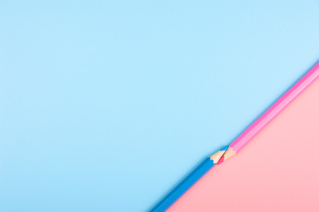 blue and red color pencil on blue and red background Stock Photo