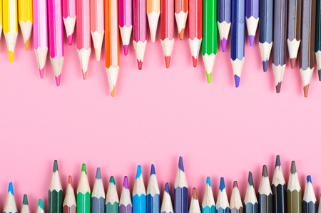 color pencils on red background Stock Photo
