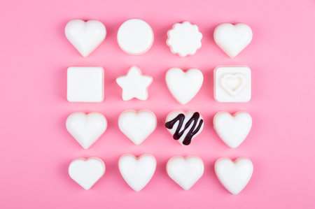 white heart chocolate on colored background Stock Photo