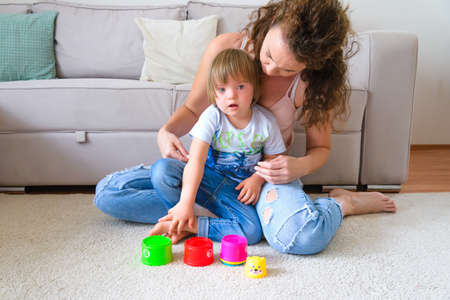 Mom and her disabled son playing in living room