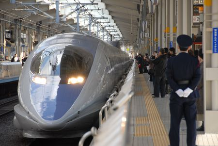 bullet train and guard on platform