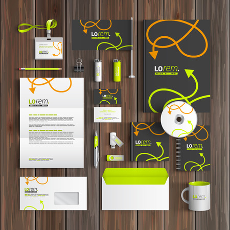 stationery: Black corporate identity template design with green and orange arrows. Business stationery