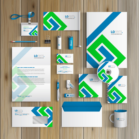 White corporate identity template design with blue and green geometric elements. Business stationery