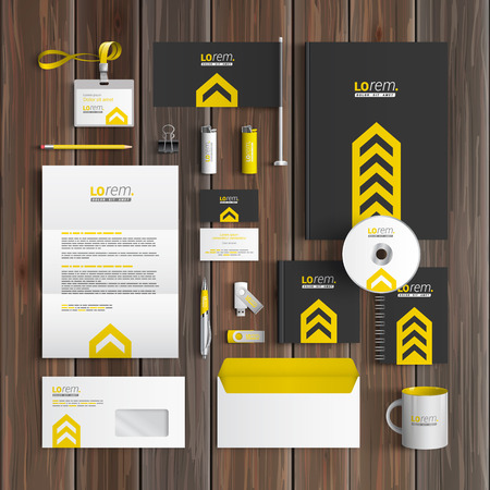 Classic black corporate identity template design with central yellow arrow. Business stationery Vettoriali