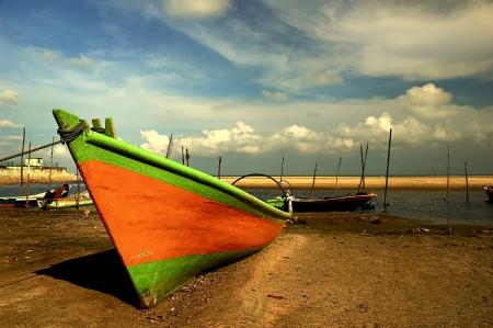 pahang: Fishing boat at Cherating Beach in Kuantan, east coast of Malaysia Stock Photo