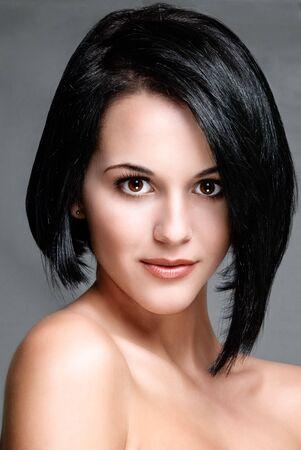 short hair: pretty female model facing camera head shot