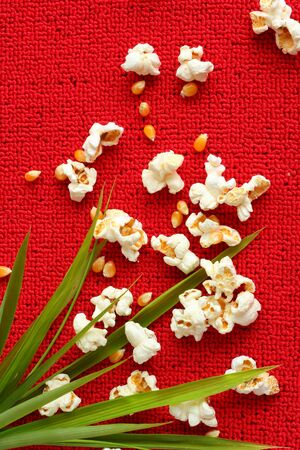 buttered: Popcorn on red background