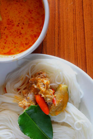 Rice noodles with spicy sauce photo