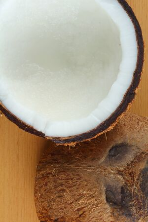 copra: Coconut on wood background
