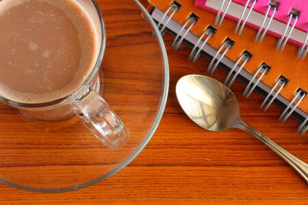 Hot chocolate and notebook photo