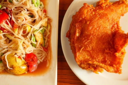 Papaya salad and  chicken fried photo