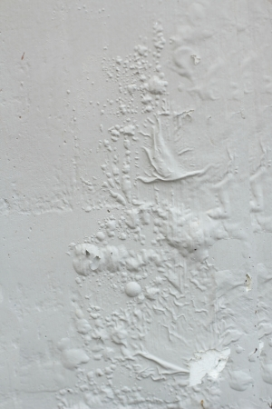 Paint blistering on concrete wall Stock Photo
