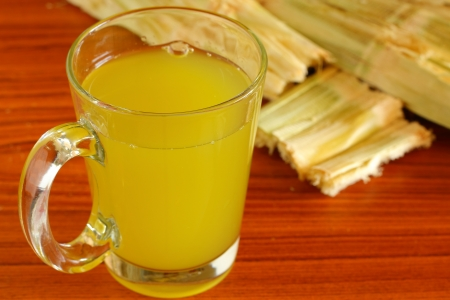 Molasses and sugar cane  Stock Photo - 17266980
