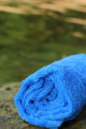 Blue spa towels on rock photo