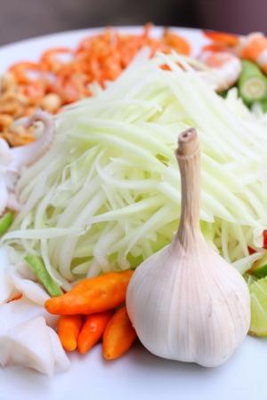 Papaya salad ingredients on wood background photo